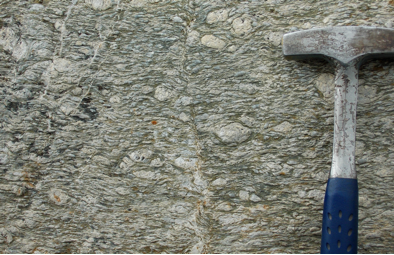 Augen gneiss, showing eyes of feldspar wrapped by the alpine foliation. Depth of deformation ~ 25 km
